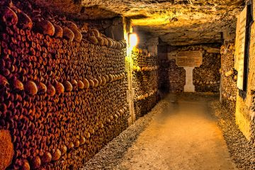 Hallway of the Catacombs, lined with skulls and bones.