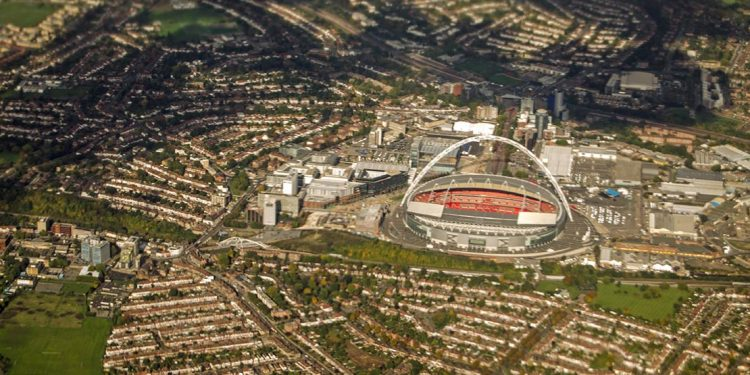 Overhead view of open topped stadium with surrounding neighborhoods.