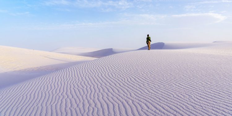Person standing on white sands