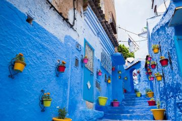 blue buildings on a street in Chefchaouen