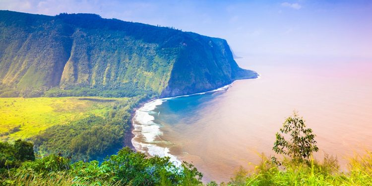 the cliffs of hawaii tower over a vast ocean expanse