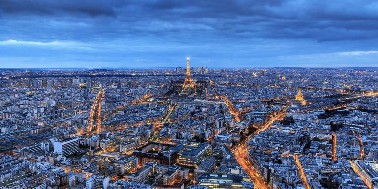 the eiffel tower and the paris skyline as seen from the seline