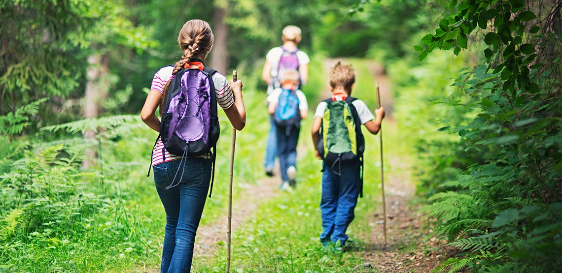 backpacking group hikes up a mountain path