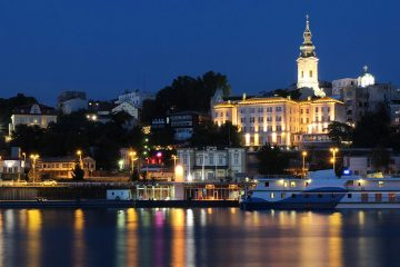 Belgrade cityscape at night with lights reflecting on the water