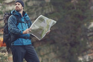 backpacker with a map