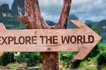 wooden sign that reads Explore the World