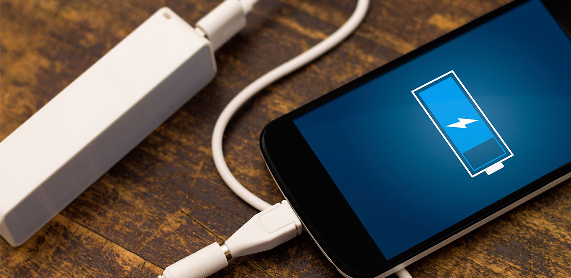 A battery backup charger for smartphones lay on the table.