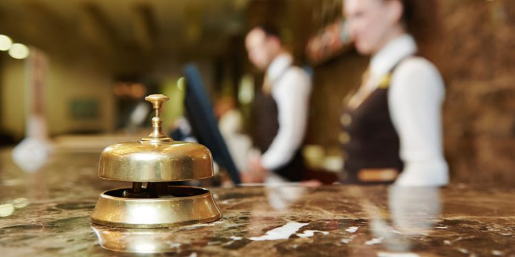 A hotel bell located on the front desk counter