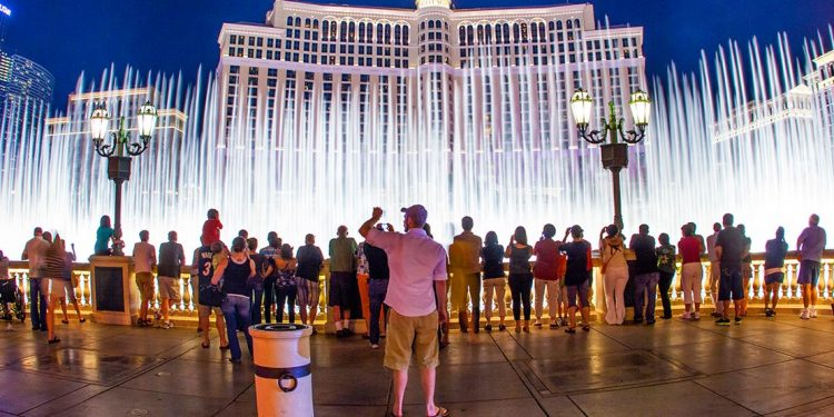 A crowd gathers in front of the water fountains at the Bellagio Conservatory in Las Vegas, Nevada