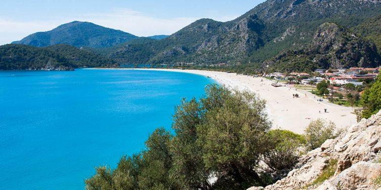 Aqua ocean meets the sand in Oludeniz, Turkey