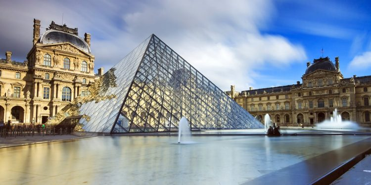 The glass pyramid and fountains outside The Louvre