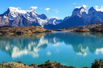 mountains surrounding a light blue lake