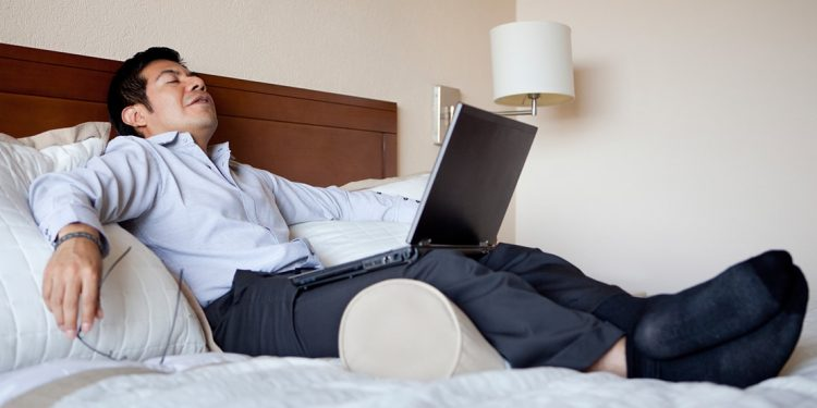man relaxing after traveling all day