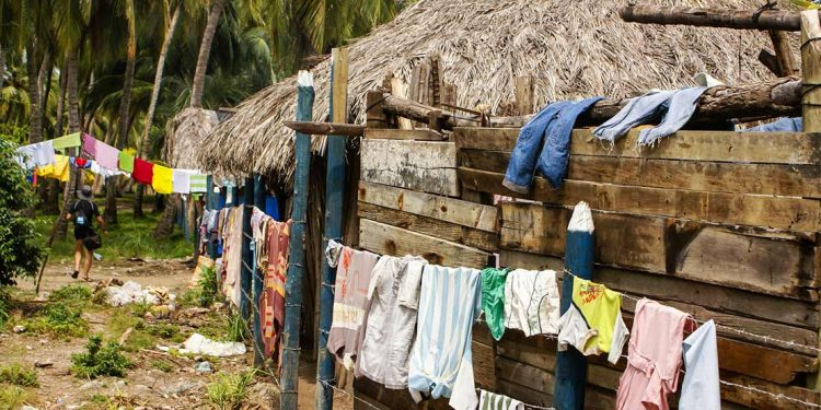hut with clothes drying outside