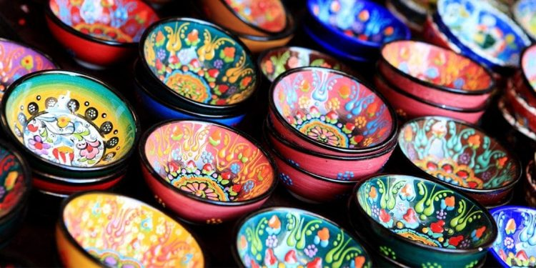 colorfully painted trinket dishes at a craft market