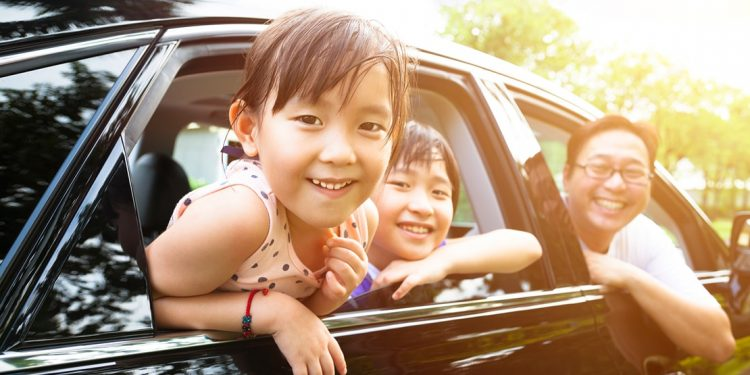 smiling family in a car