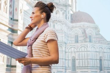 woman with earphones in holding a map