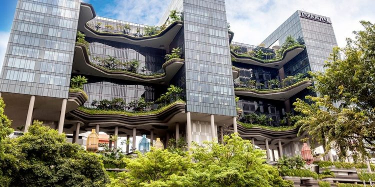 multi-story hotel surrounded by lush greenery