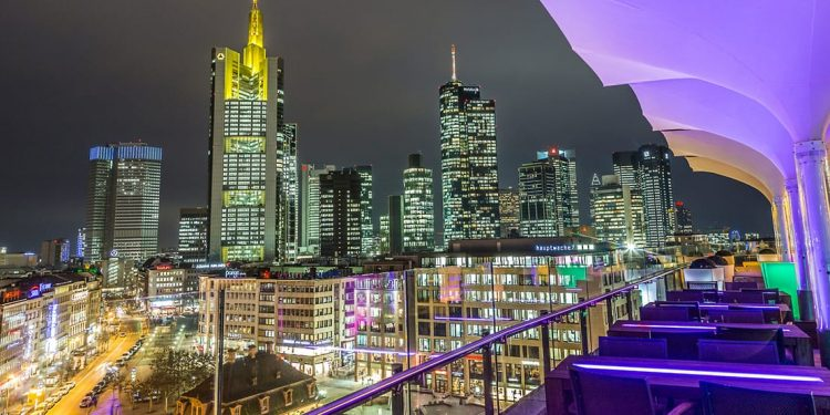 rooftop patio overlooking city at night