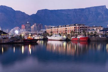harborfront in cape town, south africa with mountains in the distance