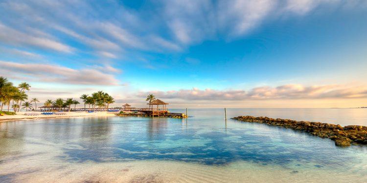 beautiful turquoise waters at nassau, bahamas beach during sunrise