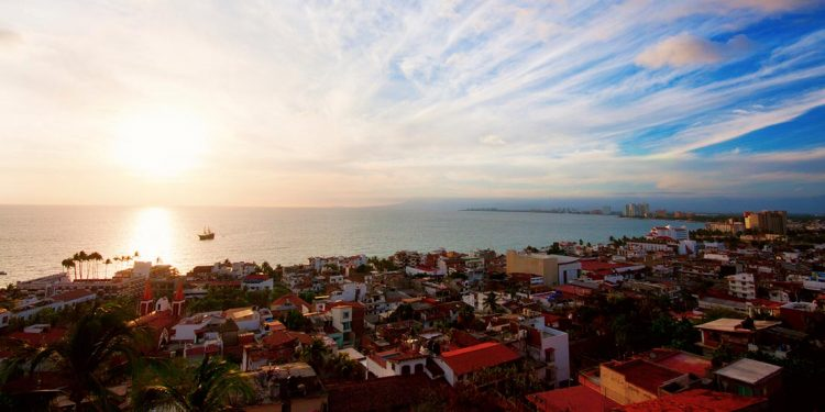 puerto vallarta, mexico overlooking the ocean as the sun starts to rise