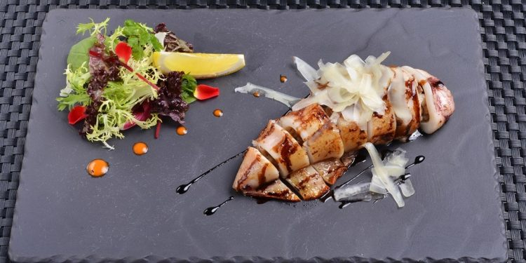 grilled squid stuffed with mixture and assorted salad on the side