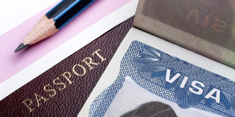 close up of passport and visa on a table
