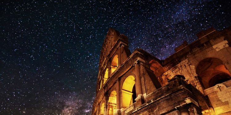 roman colosseum against starlit sky