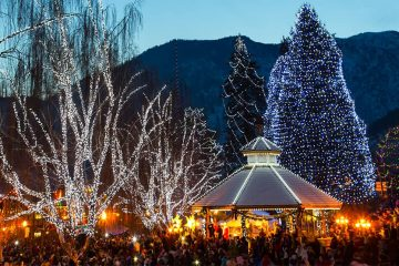 Trees and a bandstand lit up with Christmas lights in Leavenworth, Washington