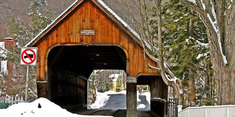 Piles of snow in front of covered bridge in Woodstock, Vermont