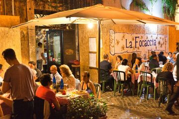Outdoor seating at an Italian restaurant at night