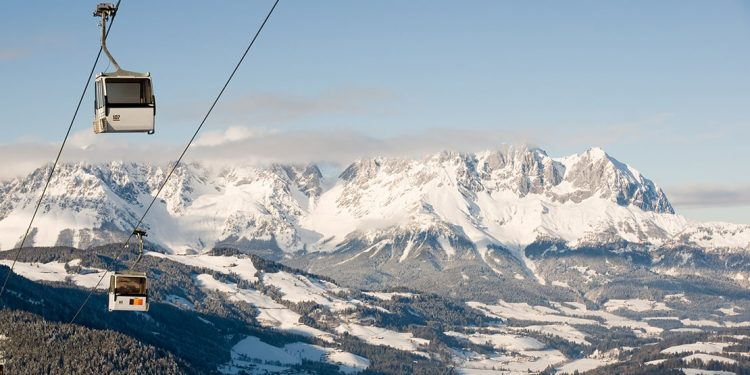 Chair lift with snowy mountains beyond in Kitzbühel, Austria