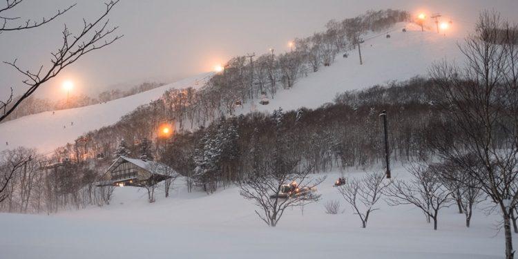 Ski hill lit up at night at Niseko, Japan