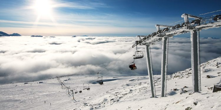 Chair lift carries people up a the mountain at Whistler Blackcomb in BC