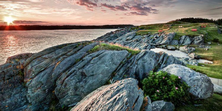 Sun rises over a rocky coastline in Canada