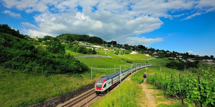 A train travels through the Swiss countryside