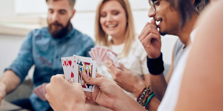 Group of four people playing a card game