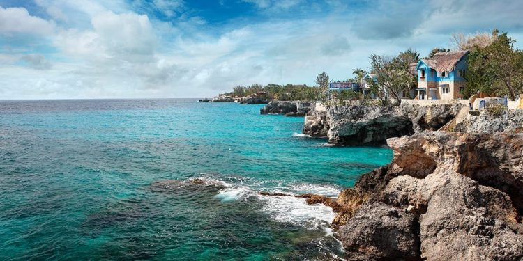 cliffs overlooking turquoise water in negril, jamaica