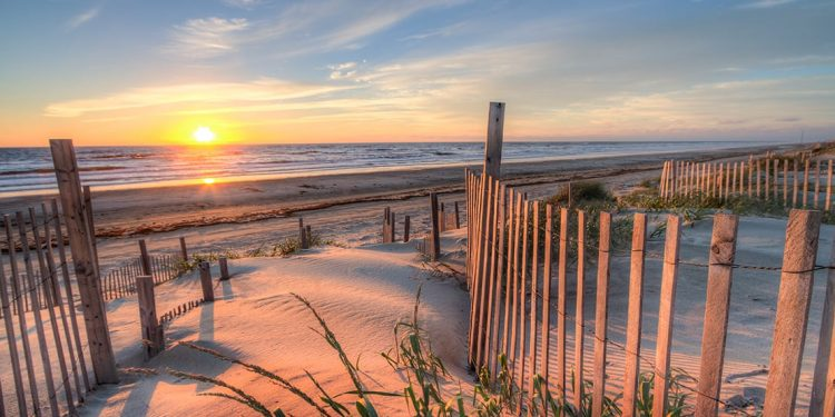 Sun sets over the beach in Outer Banks, North Carolina