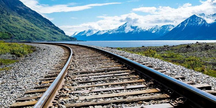 Train tracks with mountains in the background