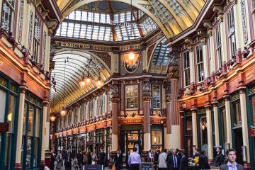 The inside of a London mall contains old architecture reminiscent of a traditional train station