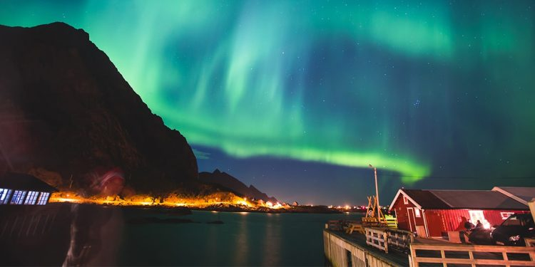 Beautiful green Northern Lights dance around Tromso, Norway's beautiful night landscape