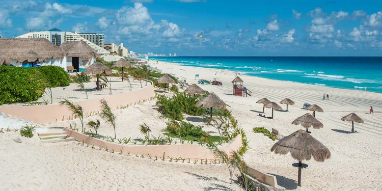 A resort in Mexico contains miles of white sand beaches and beautiful turquoise ocean waters