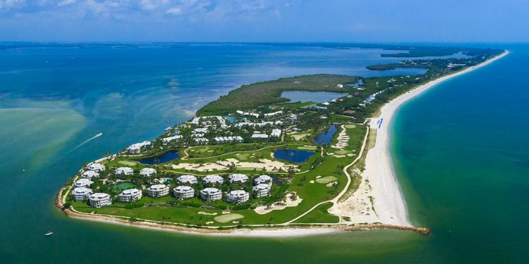 A private island includes numerous hotel buildings, golf courses, beaches, and plenty of nature