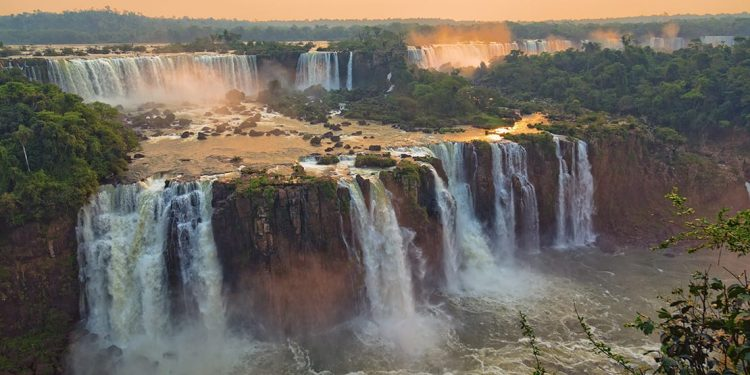 A landscape aerial photograph of the Iguazu Falls in South America