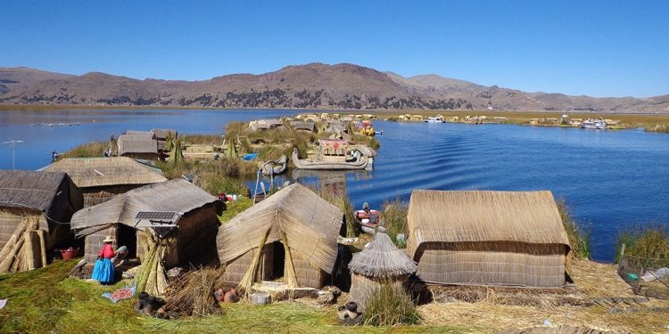 A small village continues its day-to-day living by the lake