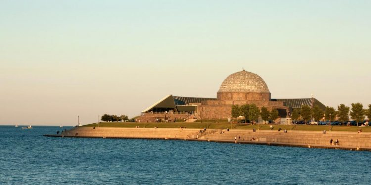 The dome shaped planetarium sits at the edge of Lake Michigan.