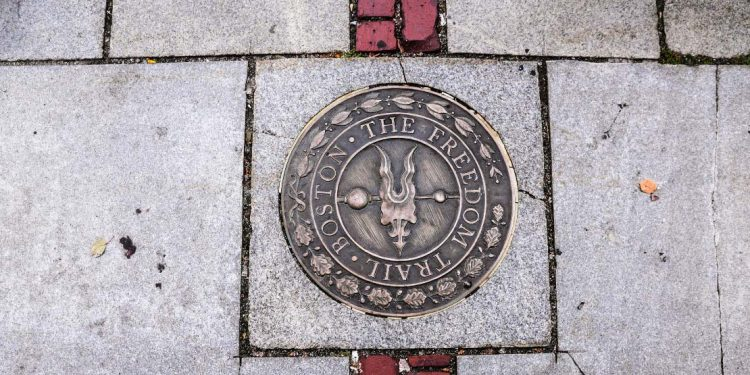 A bronze marker in the sidewalk along the Freedom Trail.