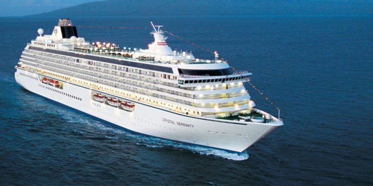 White cruise ship on the ocean.